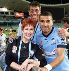 Two of Sydney FC's biggest fans, Phil Hope & Christine Whyte, with former Sydney FC player Ali Abbas in April 2016.