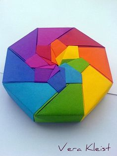 Rainbow Box tutorial: http://usefulorigami.com/origami-box-with-a-lid/ | Requires double-sided paper.