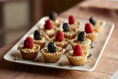 Cocktail parties will be sweeter with the addition of these sweet and savory cheese tartlets topped with raspberries and blackberries and dr