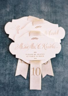 Calligraphy Escort Cards - designed by Easton Events - Destination Wedding Planners with offices in Charleston, SC and Charlottesville, VA photo by Jose Villa