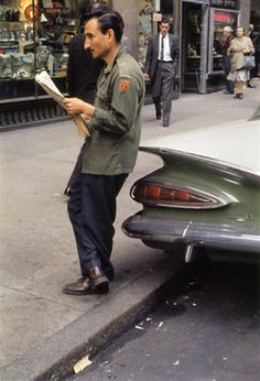 Helen Levitt- He looks like his car,the curve of his nose,part in his hair, and color of his coat.