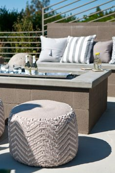 These lightweight chevron poufs — a steal at $40 from HomeGoods — are a favorite of the couple because they can easily be moved outside when more seating is needed around the fire pit.