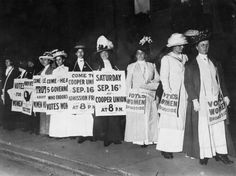 Suffrage Speech Society Society women wearing sandwich boards to publicise a talk at Cooper Union by the governors of the states which have granted the vote to women.