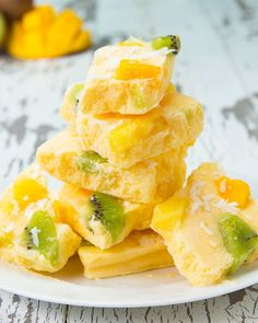 Servings: 4-6INGREDIENTS1 cup mango1 cup pineapple2 cups Greek yogurtToppings:MangoPineappleKiwiCoconutPREPARATION1.In a blender, mix fruit until consistency is smooth. Add in yogurt and blend until fully mixed. 2.Pour mixture onto a baking pan lined with parchment paper. Add desired amount of toppings. 3.Freeze for 6 hours, or overnight, until frozen solid. 4.Break yogurt bark into desired number of pieces.5.Serve cold, or store in a closed container in the freezer. 6.Enjoy!