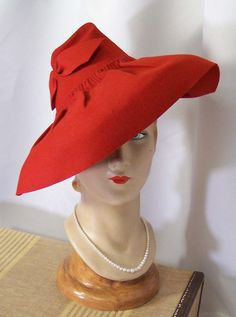 Circa late 1930s Fire Engine Red Wide Brim Sculpted Tilt Hat.