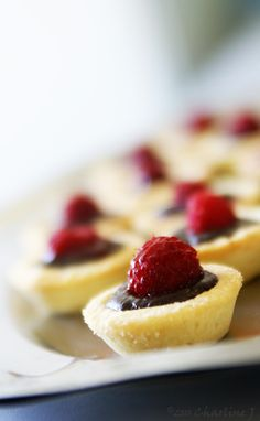 tartlets with dark chocolate and raspberries