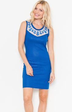 Round neck sleeveless chevron stripe embossed bodycon dress featuring rhinestone detail on mesh neckline and mesh back. Wear under a furry coat for a very fancy dinner dress. Price Per Piece $11.95