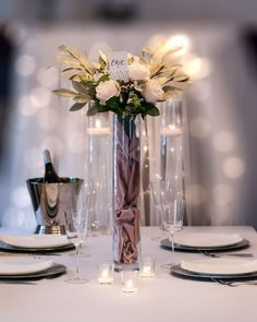 Our tall cylinder vases are tall, elegant, and command a presence. The clear glass can be matched with other cylinder vases and candles for a custom, multi-level centerpiece. Candle Centerpieces, Wedding Centerpieces, Wedding Decorations, Table Decorations, Wedding Designs, Wedding Styles, Tall Cylinder Vases, Floating Candles, Event Design