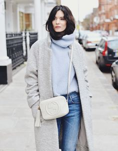 This look is perfect for those chiller fall days. A powder blue turtleneck sweater paired with a heather grey coat and Gucci cross body purse.