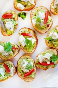 101 recipes to try now - Forget cheese and crackers—put out a platter of this guacamole and shrimp ceviche toast for guests.