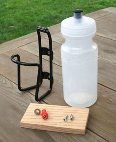 How To Make A Nipple Waterer For Chicks ::: Coop Thoughts Blog  uses water bottle and bike water holder.
