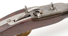 Pontcharra-Delvigne Mle1837 carbine    Manufactured in France c.1830-50′s.  .65 caliber ball, 40cm long smoothbore barrel, percussion Pontcharra breechloading system, saddle ring.  Designed as an elite cavalry carbine, it was an early breechloading military firearm using a removable breech block secured with a hinged piece on the gun. It was never adopted beyond regimental level.