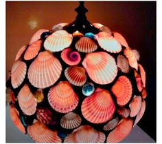 Calling all mermaids, sailors and ocean lovers! This seashell light fixture is the best. Wish I could make it DIY style. HMMmmmm...