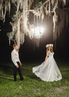 How do you even begin to describe such a dreamy wedding? Polinas and Robertas chose to tie the knot at Litchfield Plantation on Pawley's Island, SC. The couple invited just 10 guests all from different countries; they also incorporated their Russian and Ukrainian traditions into their big day. Polinas's mother brought the bride a traditional Ukrainian flower headpiece as well as her custom-designed wedding gown from Russia. To top it all off, the minister who officiated the ceremony took a…