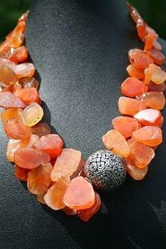 Carnelian flat slab beads with ornate silver bead