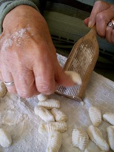 Rolling gnocchi the argentine way!  Wow - this looks like my abuela's hands.  Watching her rolls these when I was 4.  I still remember.