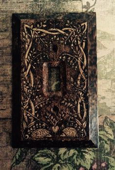 Sharing the Hedge - Woodburned Celtic Hedgehog Switch Plate Light Switch Cover.   A personal favorite from my Etsy shop https://www.etsy.com/listing/237791040/hedgies-in-the-hedge-single-switch-cover  Hedgehog, hedgie, pyrography, wood burning, light switch cover, whimsy, celtic, home decor, nursery decor, woodland, vine