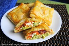 Avocado, Cream Cheese, and Salsa Pockets. I used crescent rolls (they were out of puff pastry) and added shredded chicken, cilantro and green onions. Yum!