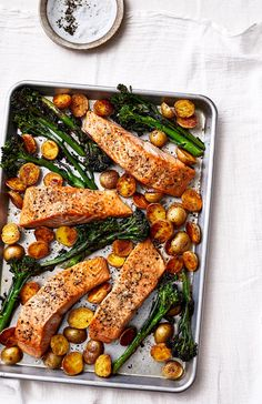 Sheet Pan Salmon With Potatoes and Broccolini Not only does this simple salmon and veggie dinner come together on one sheet pan it keeps your shopping list shorta double. Fish Recipes, Seafood Recipes, Dinner Recipes, Cooking Recipes, Quick Recipes, Indian Recipes, Vegaterian Recipes, Healthy Salmon Recipes, Cooking Games