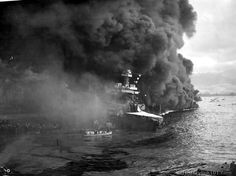 The USS California after the Japanese attack on Pearl Harbor, Dec. 7, 1941. Abandoning ship.