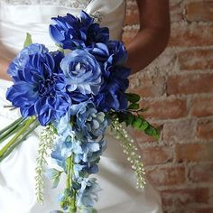 Blue bouquet for a beautiful blue wedding. Find more wedding bouquets at www.afloral.com