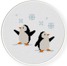 Penguins Christmas cross stitch.