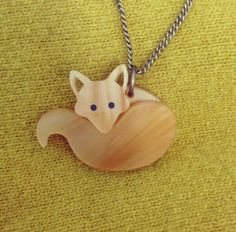 Our cute Fox Necklace is curled up on a cosy Cos cardigan today. Adopt your own little fellow now: http://www.tattydevine.com/fox-necklace.html