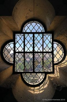 Window in the stairs of South Tower, Notre Dame, Paris, France