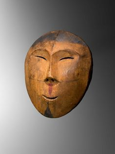 Inupiaq mask. Wood highlighted by paint pigments Point Hope, Alaska, 19th century Provenance: a seafaring family's estate, New England, USA