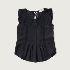 Abercrombie & Fitch Embroidered Lace Cami (760 ZAR) ❤ liked on Polyvore featuring tops, white, lace camisole, white lace cami, lace tank, ruffle tank top and white lace tank top