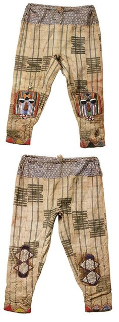 Africa   Drawstring trousers from the Yoruba people of Nigeria.   The embroidery and beadwork is on Yoruba Ashoke strip woven textiles   © Tim Hamill