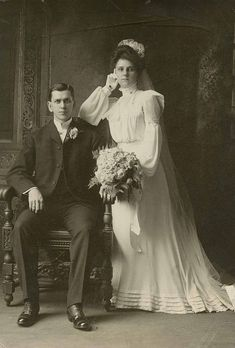 I'm VERY much in love with vintage wedding photos...I love how serious and stiff they always look because they had to hold the pose for those long exposures