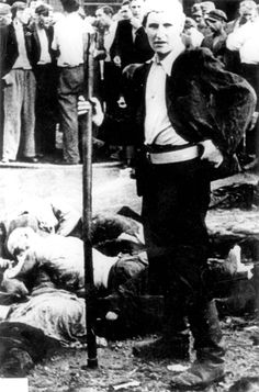 Kovno, Lithuania, A rioter in a pogrom, standing next to corpses.