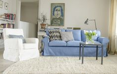 Ektorp 3 seater sofa cover in Light Denim Blue Belgian Linen. Jennylund, Loose Fit style, Rosendal Pure Wash Linen Absolute White. Cushion covers in Sandhamn Stripe  Black/White and Toronto Ticking Teal Blue. www.bemz.com