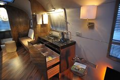 AIRSTREAM Architect Series: Overlander 1967 Conversion: After.like the angled wood floor install. Airstream Caravans, Airstream Remodel, Airstream Interior, Vintage Airstream, Vintage Trailers, Vintage Campers, Airstream Motorhome, Airstream Decor, Airstream Living