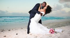 Bride & groom kiss on the beach after their wedding ceremony at Beach Palace in Cancun, Mexico #destinationwedding