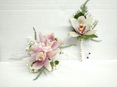 Mini pink cymbidium orchid corsage and boutonniere with white and pearl accents.