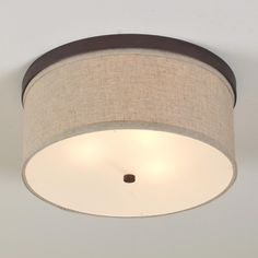 Create a clean look on your ceiling with a linen drum shade ceiling light. Sleek metal band housing holds a soft white linen drum shade and an acrylic diffuser for soft light. Bronze is also available with an oat linen shade. Drum Ceiling Lights, Ceiling Light Shades, Ceiling Light Design, Semi Flush Ceiling Lights, Flush Mount Ceiling, Flush Mount Lighting, Ceiling Light Fixtures, Ceiling Lamp, Lamp Light