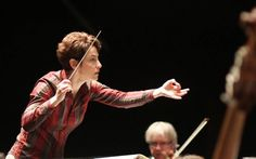 Laura Jackson rehearses with the Orchestre Symphonique de Bretagne in France. She will conduct the San Luis Obispo Symphony in concert on Saturday, Feb. Conductors, San Luis Obispo, Einstein, Jackson, Entertaining, Female, Concert, Music, France