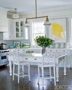 Love the all white kitchen with the detailed kitchen table and chairs. Nice accent of green to bring spring in