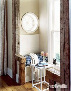 """This tiny window seat """"was a total departure from the rest of the house—a renovated barn that's open and expansive.... It's a place to catch your thoughts, to reach inwardly and contemplate,"""" said designer Pat Healing. Douglas Friedman  - HouseBeautiful.com"""
