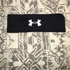 Under Armor headband with grips Super cute headband I've gotten a good amount of use of. Still in good condition and has the grips on the inside so it won't fall off. Not stretched out or anything like that. The back of the headband is very neat looking as you can see. It's black and gray. Under Armour Accessories Hair Accessories