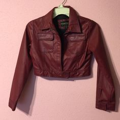Bolero Styled In Faux Leather Deep Burgundy Bolero Jacket.   Zipper front. Sleeve, and below zipper Velcro to tighten. Pocket on each side. There are a few tiny flaws . Fun little jacket for work or play.. Material 70%! Polyvinyl &  30%Polyurethane.  Lining 100% Polyester Rampage Jackets & Coats