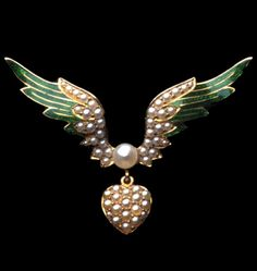 A Victorian pearl and enamel heart and wing brooch, circa 1880. Centring a 5mm pearl with wings at either side, pavé-set with half-pearls and outer feathers decorated with green enamel, suspending a heart pavé-set with half-pearls, in all yellow gold mount. #Victorian #brooch