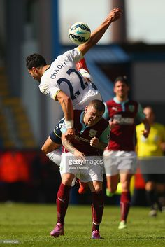 Nacer Chadli of Spurs climbs above Kieran Trippier of Burnley during the Barclays Premier League match between Burnley and Tottenham Hotspur at Turf Moor on April 5, 2015 in Burnley, England.
