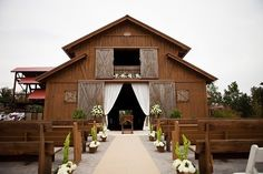 barn wedding curtains closed for ceremony and open up for reception inside.