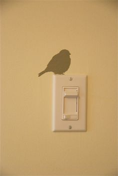 bird on a light switch (*i kinda like the lil' bit of whimsy ... unexpected!) I cut a robin silhouette with my cricut and put it on the light switch in our livingroom! I then put a pheasant in the familyroom and a chicken in the kitchen! Fun!