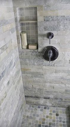 Bathroom Tile. Mine looks close to this. I have 2x6 in my master shower and I love love love it. My master bath is small but it looks huge now. Feels that way too.