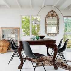 i like the lamp arched over that big mirror.