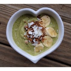 Mango•Spinach smoothie bowl. 2 frozen bananas, 1 cup frozen mango chunks, handful of spinach, almond milk, and one medjool date.  Blend really thick and top with more banana, coconut, and some granola.